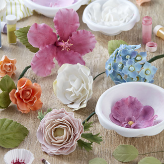 Variety of finished colorful gum paste flowers.