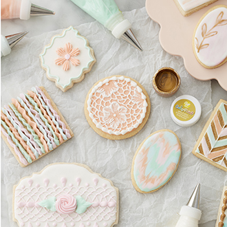Pastel decorated cookies using lace, embroidery, painting, and ruffle techniques