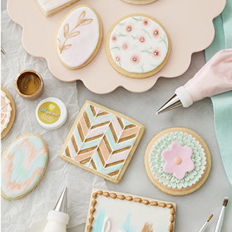 Pastel decorated cookies using painting, fondant, and watercolor techniques