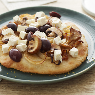 Caramelized onion and mushroom flatbread pizza with feta cheese