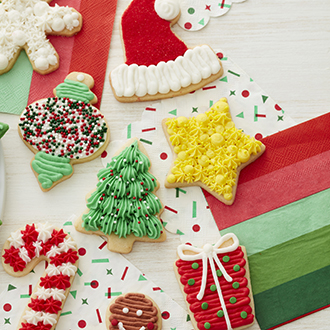 Traditional Christmas-themed cookies iced in buttercream.