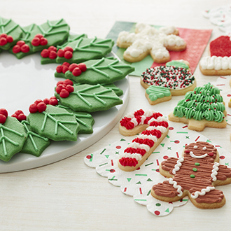Arrangement of traditional Christmas-shaped cookies on a table.