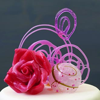Grouping of 3 Isomalt cake toppers on top of fondant cake.
